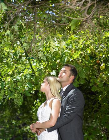 Bride and groom relaxing in woods