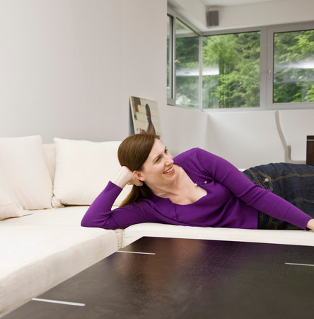 Woman laying on the couch Stock Photo