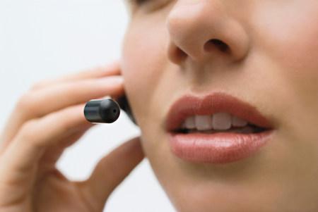A woman wearing a headset