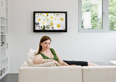 Portrait of woman laying on couch