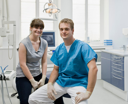 Portrait of a dentist with assistant