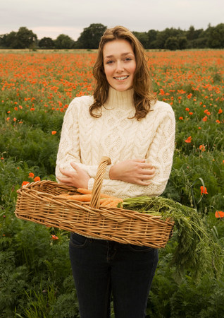 A female holding a basket of vegetables