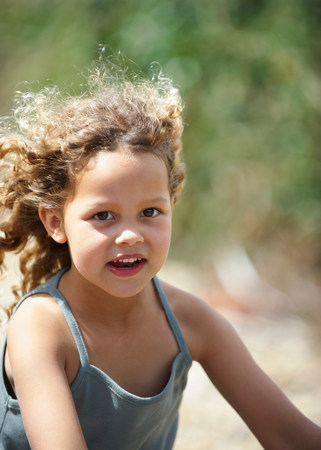 Young girl riding bicycle wind in hair Stock Photo