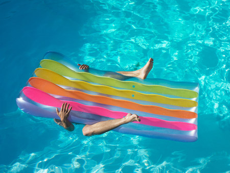 Man under pool inflatable Stock Photo