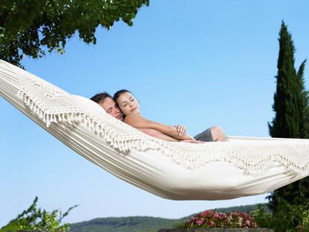 Couple relaxing on hammock
