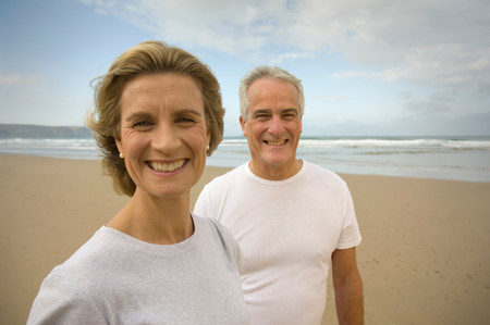 Portrait of couple smiling on a beach Stock Photo
