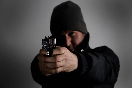 Male holding gun Stock Photo