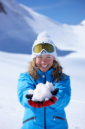 Woman laughing,  holding snowball Stock Photo