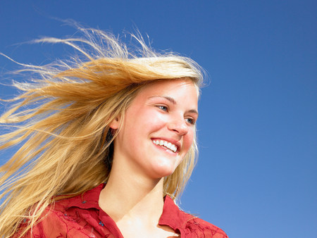 Girl smiling,  wind in her hair