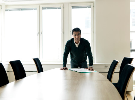 Business man by conference table