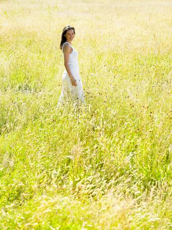 Woman walking in a field 免版税图像