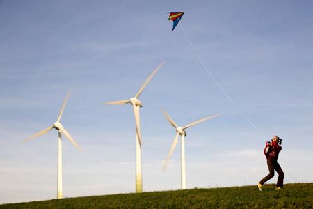 Girl Flying Kite at Wind Turbines