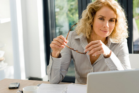 Woman working at office or home