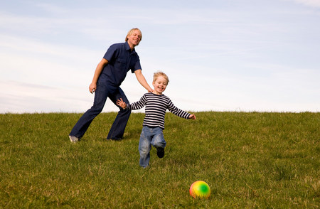 Boy and father play ball Stock Photo