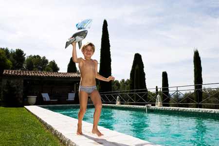 Boy running at swimming pool