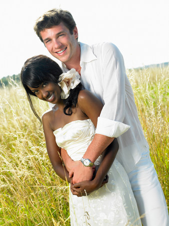 Married couple in a field Stock Photo