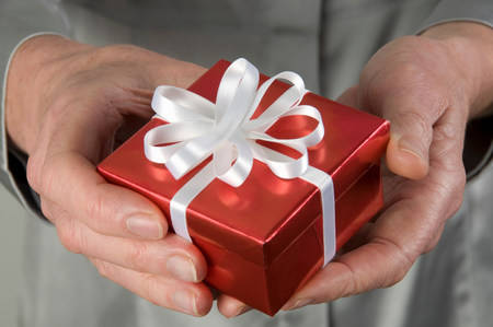 Female hand holding present Stock Photo