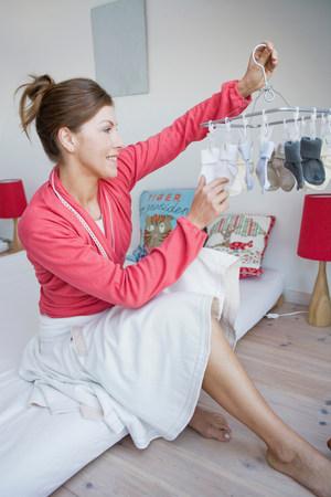 Woman regarding a set of socks