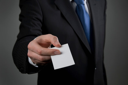 Male holding business card Stock Photo
