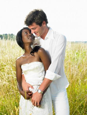 Married couple in a field Reklamní fotografie