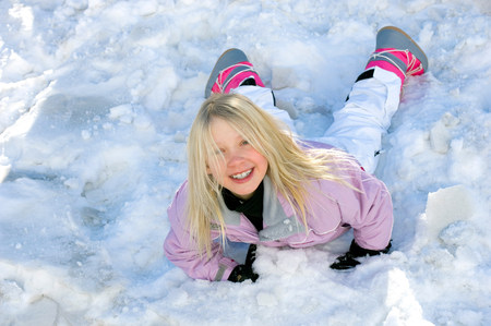 Girl rolling in snow