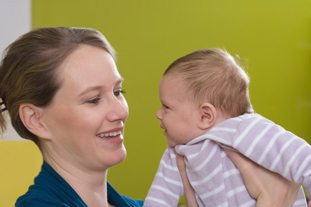 Young woman with baby Stock Photo