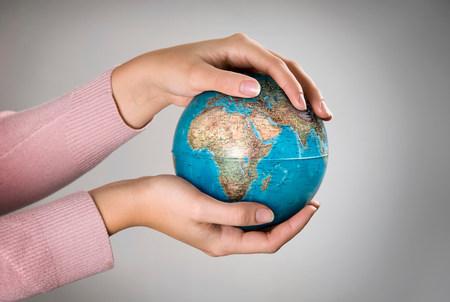 Female holding globe Stock Photo