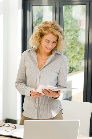Woman at work looking at papers