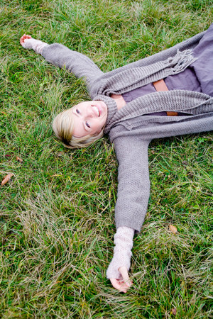 Woman lying backside on grass Stock Photo
