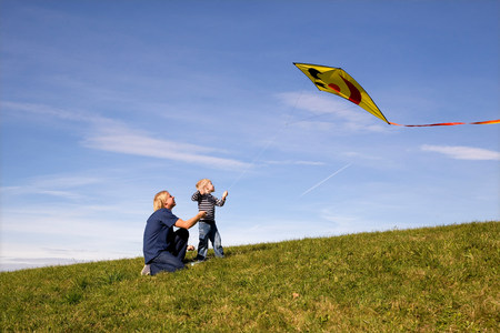 Boy and father fly a Kite