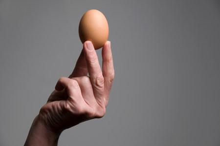Female hand holding an egg Stock Photo