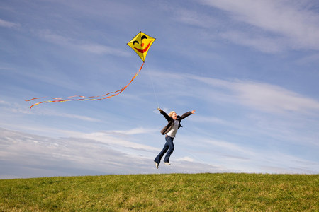 Man jumping,  flying a kite