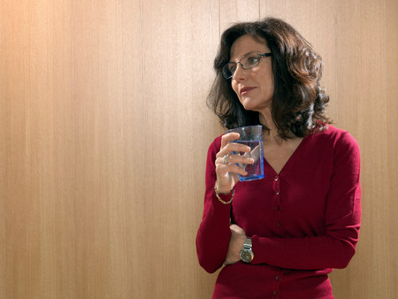 Business woman drinking water Stock Photo