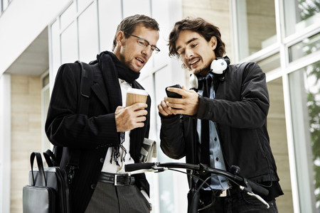 Men next to bicycle, coffee break Stock Photo