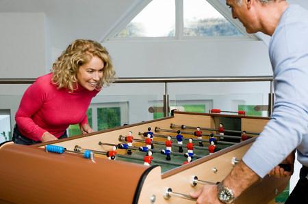 Couple having fun playing table football Stock Photo