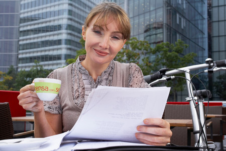 Business woman working outside Stock Photo