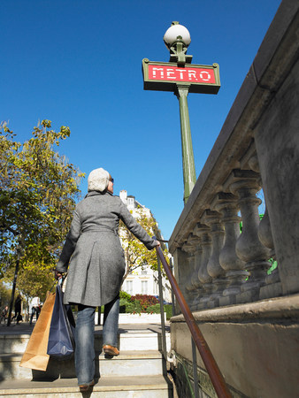 Woman walking out of Paris underground