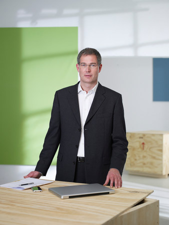 Manager standing in loft office