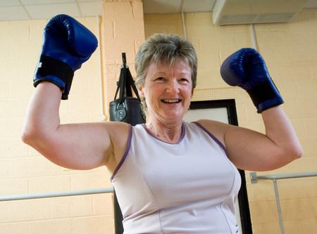 woman winning at boxing exercise at gym