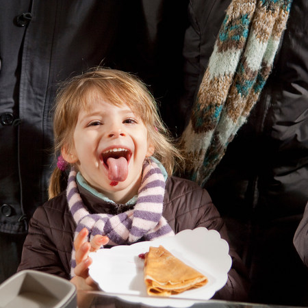 Girl eating crepe with jam