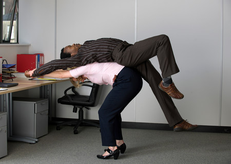 office workers stretching Imagens