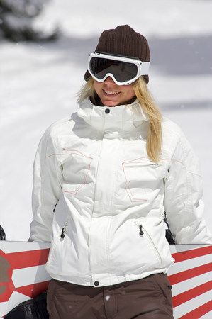 Female snowboarder walking with her snow Stock Photo