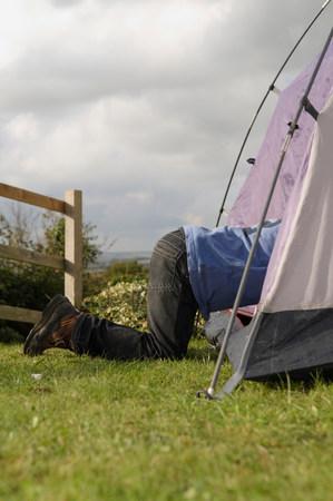 Boy climbing into tent