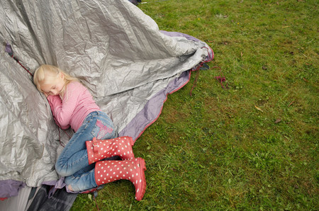 Girl sleeping on tent