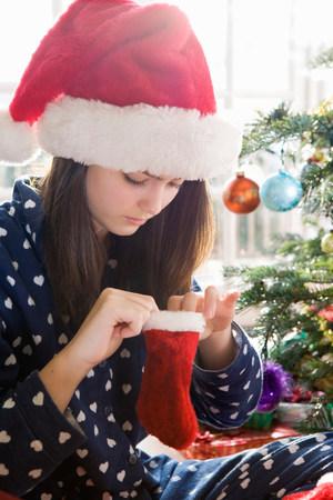 Girl, 14 with tiny Christmas stocking