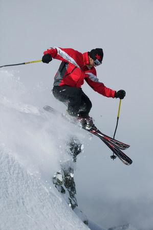 Skier jumping of a rock 免版税图像