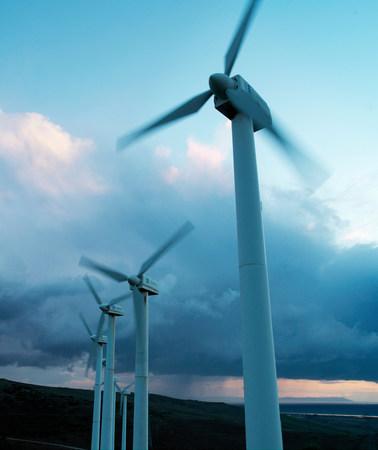 Wind turbines against stormy sky
