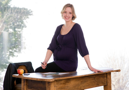 pregnant woman working in home office
