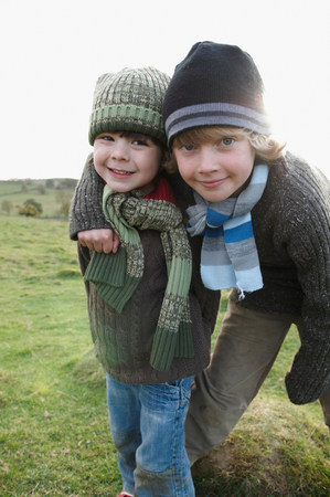 Two boys on hill in countryside Standard-Bild
