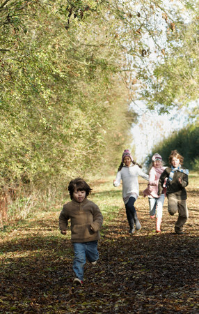 Children running down country lane